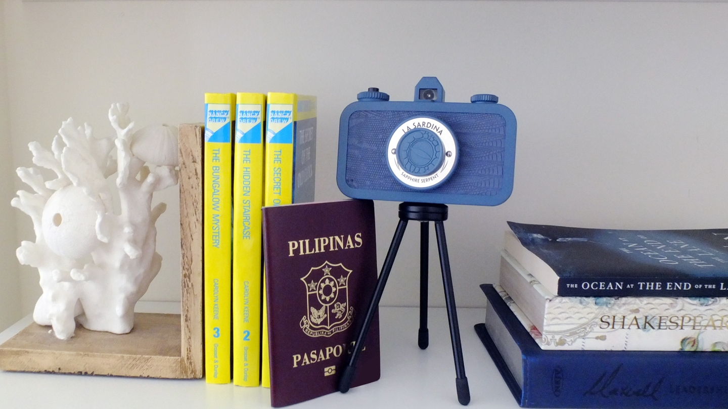 Passport Books Camera on a Bookshelf